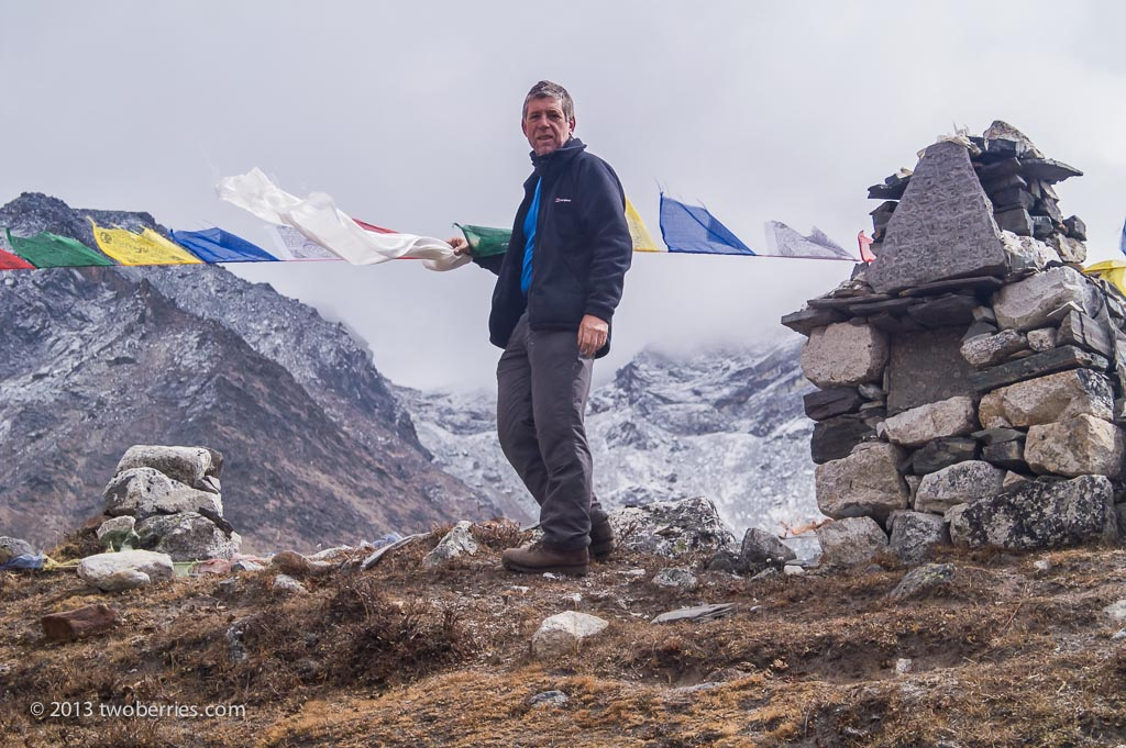 Leaving a silk scarf on the climbers monument at the base of the Khumbu Glacier